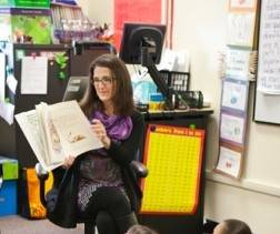 Faculty member reading to students in classroom